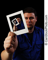 Image inside Image - Man holding a photo echoed in itself