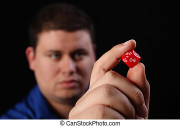 Man with Multi Sided Dice Right - A man with a multi-sided...