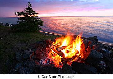 Michigan Beach Bonfire - A campfire on the beach is a...