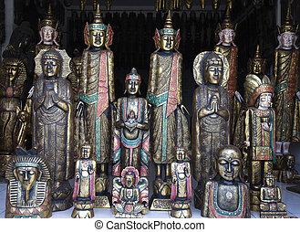 Balinese handicraft - Woodcarved buddhas for sale in a shop...