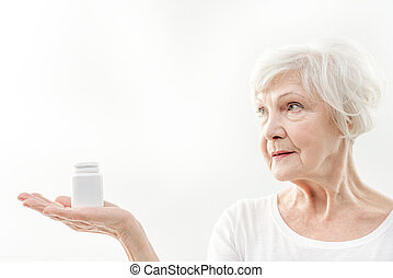 Healthy senior lady showing pills - Secret of my health and...