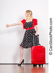 woman with red suitcase hitchhiking - Traveling vacation ew...