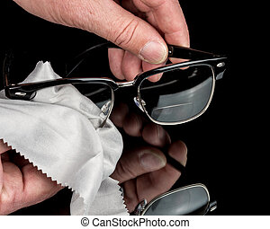 Bifocal glasses getting cleaned with a cloth - Hands do a...