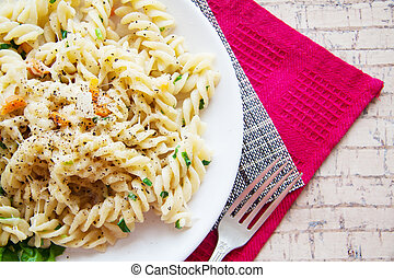 italian pasta fussili with cheese and vegetables