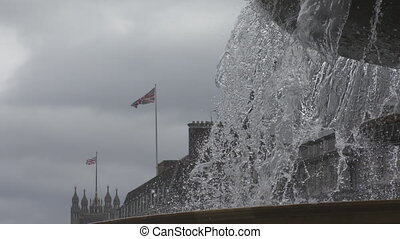 Spray of the fountain and the flag of Britain.