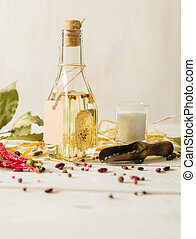 Vegetable oil in a bottle with seasonings and spices on a...