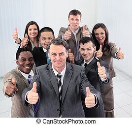 Smiling business people  looking at camera and showing thumbs up