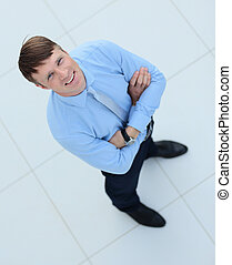 Happy middle aged man standing on isolated white background...
