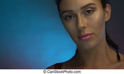 Closeup face of pretty woman in burgundy lingerie with...