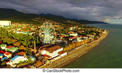 Aerial view on seashore resort area with big wheel, Black...
