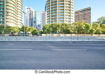 Empty asphalt road and modern buildings in Kuala...