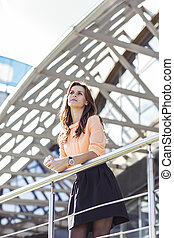 successful business woman standing on the balcony of the...