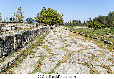 Roman era ancient street in Greece - Roman era ancient...