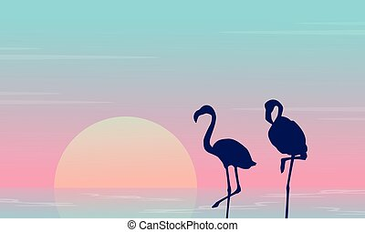 Beauty landscape with flamingo silhouette on lake