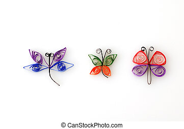 Paper Quill Insects on White Background.