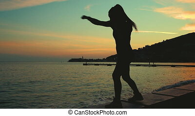 Athlete outline boxing into air on sea shore beach on sunset.