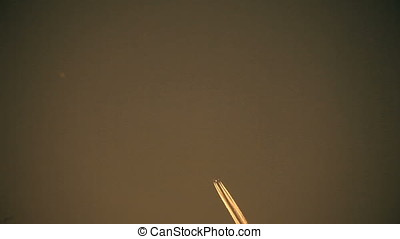 Lower Right to Upper Left Jet Airplane Contrails at Sunset -...