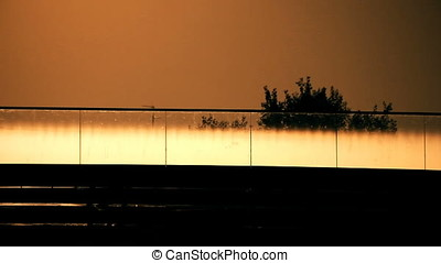 Cyclist Crossing Bridge Sunset Back Lit Silhouette - Cyclist...