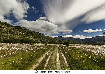 path in patagonia mountains with beautiful lenticular clouds...