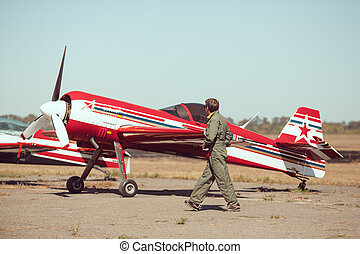 Pilot in front of vintage plane - Pilot and airplane. Young...