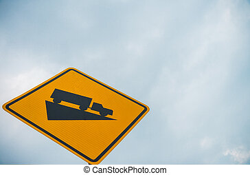 Yellow Steep truck slope traffic sign with cloudy sky