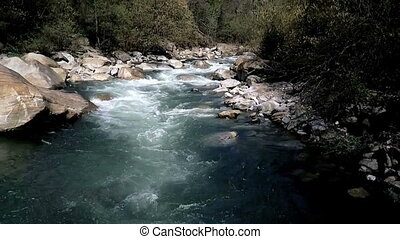 Whitewater river flight - White water river flowing through...