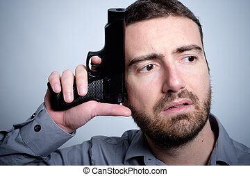 Frantic man thinking about shooting himself with gun -...