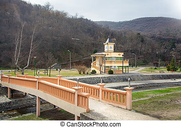 Vranje termal spa landscape with clock tower over hot water...
