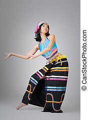 Attractive Chinese dancer in colorful traditional dress, Dai...