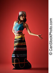 Mysterious dancer of Chinese girl in traditional colorful...