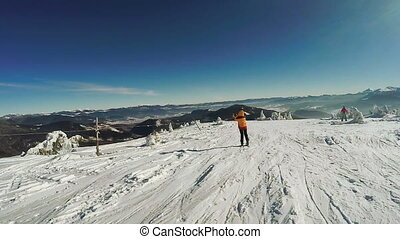 Girl on skis photographs - Against the background of the ski...