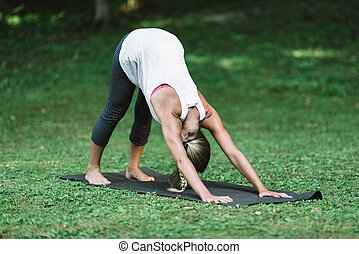 Yoga, sun salutation, downward facing dog