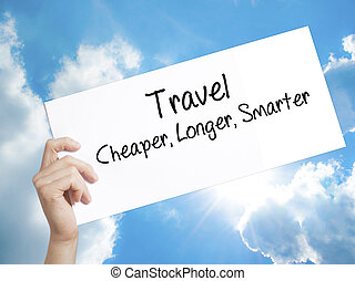 Paper with text Travel Cheaper Longer Smarter  . Man Hand Holding Sign on white paper. Isolated on sky background