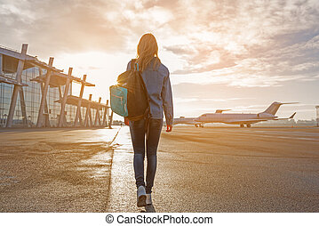 Young girl going at flying line - Female tourist walking at...