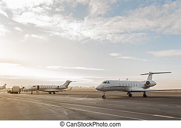 Different passenger aircrafts situating at runway - Various...