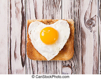 fried egg with toast on a plate