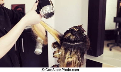 Woman getting fashion hairstyle in salon
