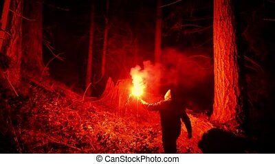 Person With Flare Walks Through The Woods - Person walking...