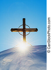 Christianity religious cross on snow capped mountain,...