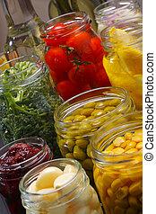 Jars with various preserved food - Opened jars in pantry...