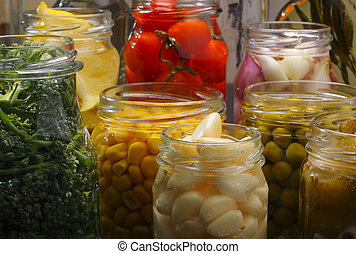 Jars with various preserved food - Opened jars in pantry...