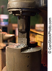 Industrial electric press in blacksmith's house.