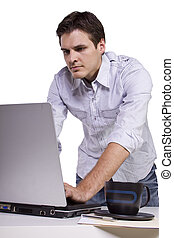 Young man browsing internet on laptop