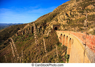 Old Sicilian railroad - View of the bridge of the old...