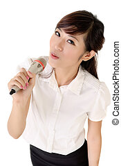Business woman relaxing and singing against white background...