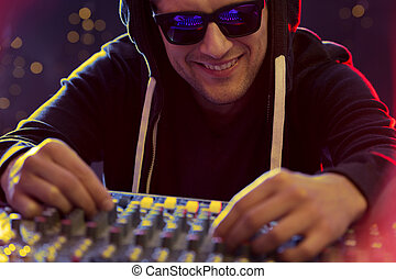 Disc jokey at turntable - Happy disc jockey at turntable,...