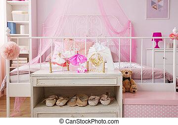 Dancing decorations in pink room of ballet dancer