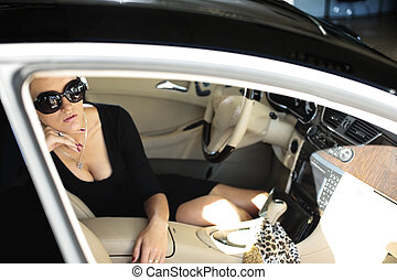 Luxury woman sitting in the car - Sexy woman in luxury car...