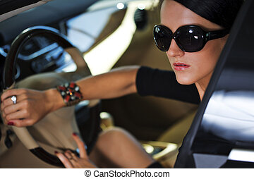 Sexy woman in luxury car - Sexy woman sitting in luxury car