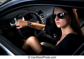 Luxury woman with long legs sitting in the car - Sexy...